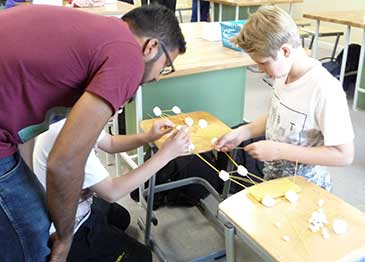 PhD student supervising bridge-building activity