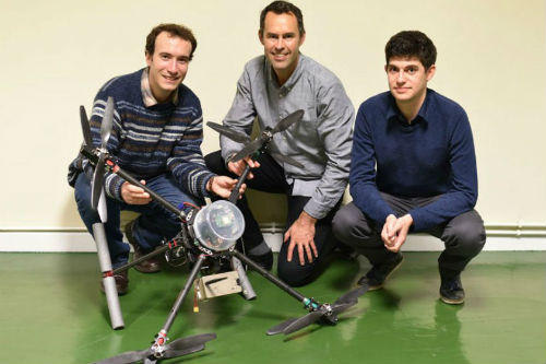 Dr Tom Scott (centre) and his Imitec colleagues with their 'drone for good'