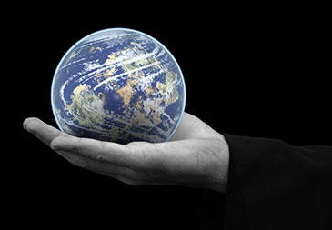 Image of the earth held in the palm of a hand