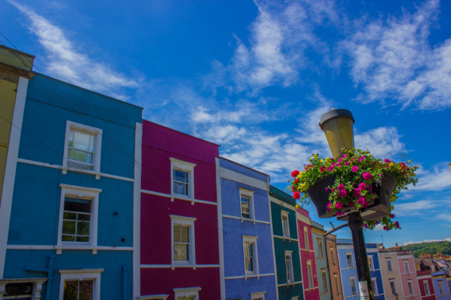 Colourful houses of Bristol with flowers and blue skies